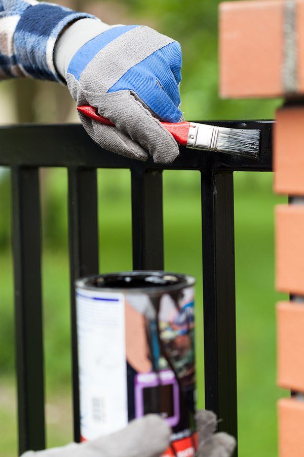 Maintaining and Painting Fence by A-1 Fence Inc